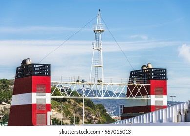 Red smokestack of a cargo ship with its look-out in the port of Barcelona, Catalonia, Spain