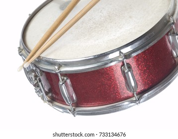 Red snare drum profile with sticks on white background