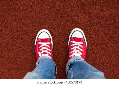 Red Sneaker on running track . top view