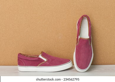 Red Sneaker on a Wood Background, slip-on shoes