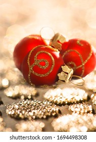 Red sniny Christmas balls on golden blurry lights background