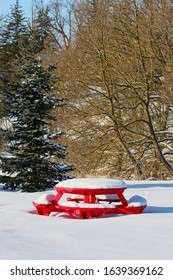 Red Snow Covered Table with Evergreen