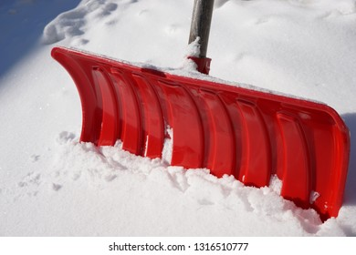 Red Snow Shovel in Heavy Snow