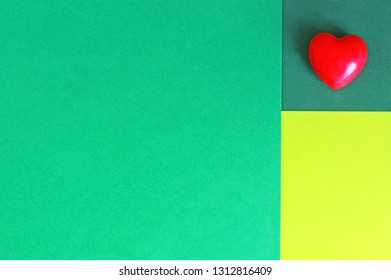 red soap in heart shape lying on a green background, valentine background