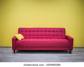 Red sofa on yellow wall background living room with copy space