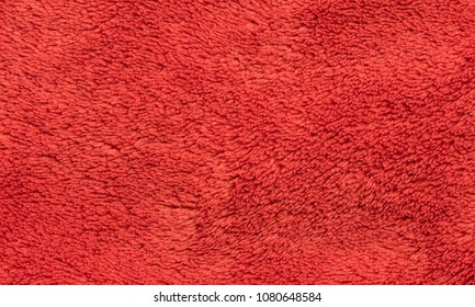 Red soft synthetic plush fleece texture background.