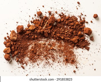 Red Soil isolated on White Background. Pile of Dirt and Stones. Top View of a Heap of Ground. Close Up Macro View
