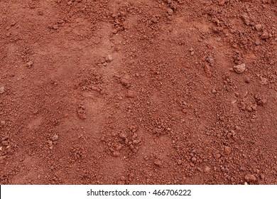 Red Soil Tropical laterite soil or red earth background. Red mars sand background. Top view