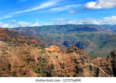 Red soil of Waimea Canyon State Park shows from the erosion of wind and rain.  Waimea Canyon is on the Island of Kauai, Hawaii.