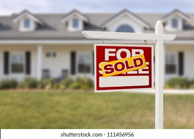 Red Sold For Sale Real Estate Sign in Front of House.