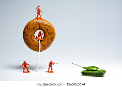Red soldiers are protecting donuts.Food and War concepts.
