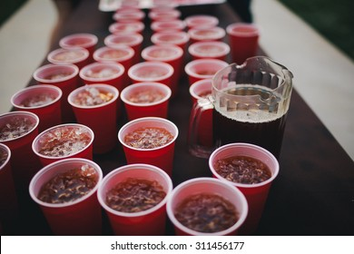 Red Solo Cups Lined Up With Iced Tea