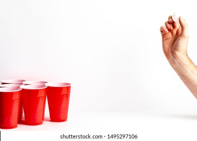 Red solo cups set up for the drinking game beer pong on a white background