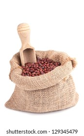 red soybeans in a wooden bowl on a wooden background