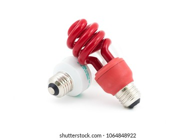 Red spectrum light bulb in fluorescent shot agains a white isolated background in studio. Red light bulbs help promote a healthy sleep cycle.