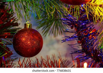 Red sphere on a pine. New year and Christmas