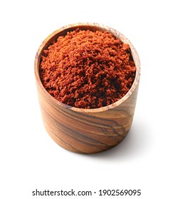 Red spicy chili powder in a wooden dish bowl isolated on white background