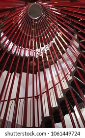 Red Spiral Metal Staircase in Tall Tower
