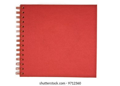 Red spiral notebook isolated on white
