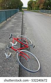 red sport bike by road side