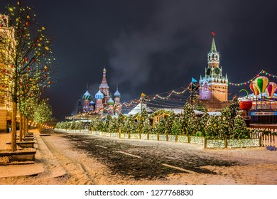 Red Square in christmas decoration. Saint Basil`s Cathedral, Upper lines (GUM department store) and Spasskaya tower in the winter night. Moscow, Russia.
