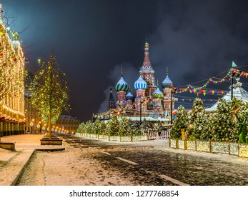 Red Square in christmas decoration. Saint Basil`s Cathedral, Upper lines (GUM department store) and Middle lines in the winter night. Moscow, Russia.