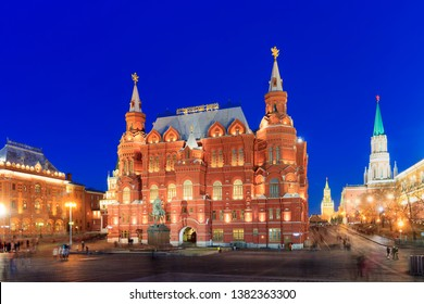 Red Square, Moscow at night. Tourists with blurry effect. Red Square and Kremlin, aerial view. Evening lighting of buildings. Moscow 30/03/2019