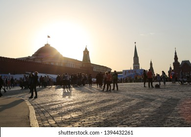 Red Square Moscow Russia 2 October2012. Photo taken against the setting sun behind the Kremlin. Bright sun creates silhouettes of kremlin and people walking on red square and standing taking pictures