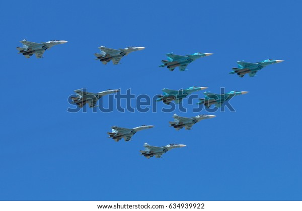 RED SQUARE, MOSCOW, RUSSIA - MAY 7, 2017: Sukhoi Su-34, Su-30SM and Su-35S airplanes of Russian Air Force during Victory Day parade rehearsal.