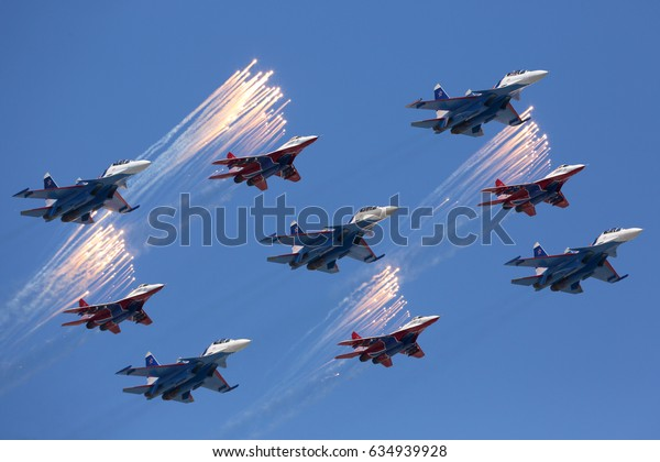 RED SQUARE, MOSCOW, RUSSIA - MAY 7, 2017: Sukhoi Su-30SM and Mikoyan MiG-29 jet fighters of Russian Knights and Swifts aerobatics teams of Russian Air Force during Victory Day parade rehearsal.