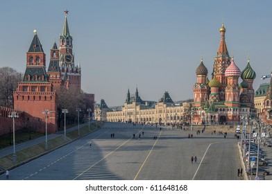 Red Square of Moscow with St. Basil's Cathedral, Kremlin Tower and GUM  (State Department Store) during the day with people walking.