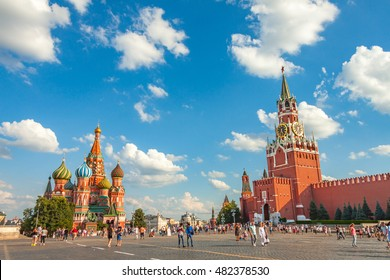Red square in the summer, view of the Spasskaya tower and Basil the Blessed Cathedral, the most famous landmark in Russia