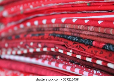 Red Stack of Fabrics
