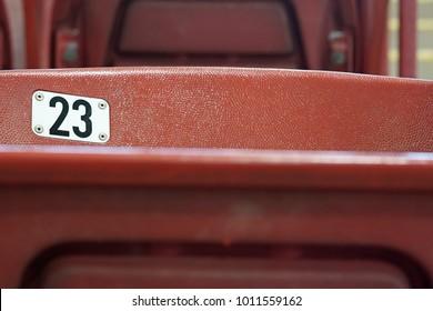 Red stadium seat number 23