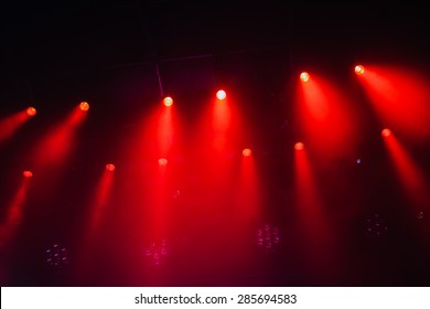 red stage lights at an open air concert