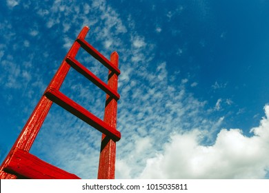 Red Staircase Rests Against Blue Sky. Development Motivation Busines Career Growth Concept