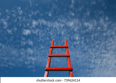 Red Staircase Rests Against Blue Sky. Development motivation Career Growth Concept