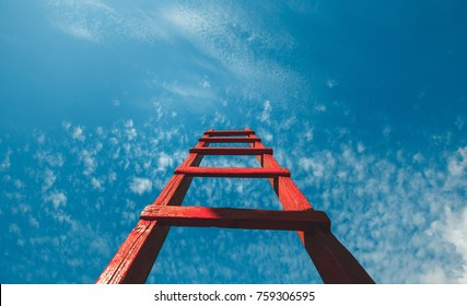Red Staircase Rests Against Blue Sky, Front View. Development Motivation Career Growth Concept