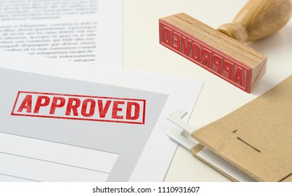 A red stamp on a document - Approved
