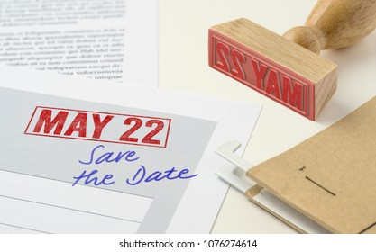 A red stamp on a document - May 22