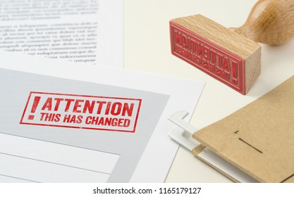 A red stamp on a document - This has changed