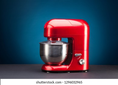 Red Stand or kitchen Mixer With Clipping Path Isolated On blue Background