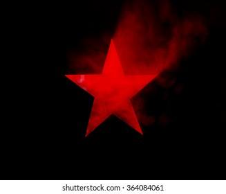 Red Star. Hole cut in cardboard, smoke machine and spotlight.