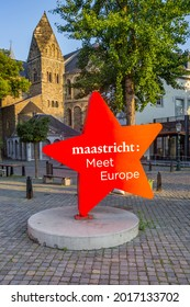 Red star icon with text in front of the church tower in Maastricht, Netherlands