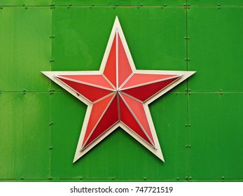 Red star on a green background.
