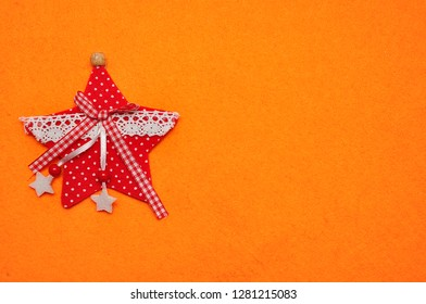 A red star on an orange background