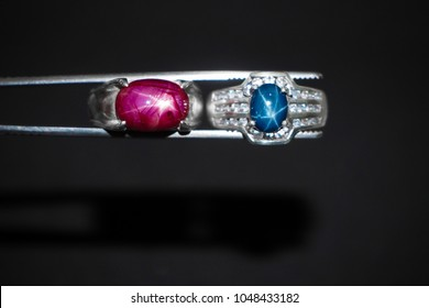 red star ruby ring and blue star sapphire ring on the black background
