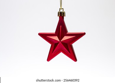 Red star shaped Christmas ornament isolated on white background