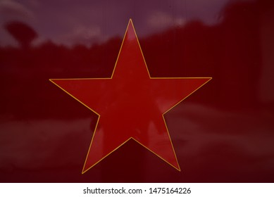 An red star symbol background.
