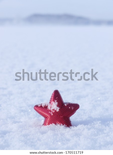 a red star in a winter landscape